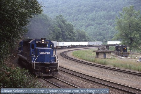 In July 1988, Conrail SD40s, working as head-end helpers, lead a westward Trailvan train around the famous Horsehoe Curve (west of Altoona, Pennsylvania). This landmark of the Pennsylvania Railroad was reduced from four tracks to three in the Conrail era, but remained a vital artery for freight. I've used a variation of this photograph in several publications including my book Railway Masterpieces.