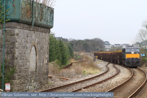 Through careful planning and expeditious driving, Noel and I were able to catch the Ballina timber a second time. It is seen here approaching Castlerea station on March 13, 2014. Canon EOS 7D  with 100mm lens. I also exposed a series of colour slides of the timber passing the signal cabin with my Canon EOS 3. The structure at the left is the old water tank, a vestige of the steam era.
