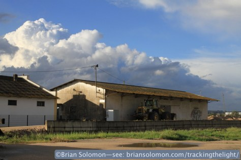 Storm clouds over the old freight house/goods store. Where was the camera club now? They'd jumped a train when it started to rain. Canon EOS 7D with 20mm lens.