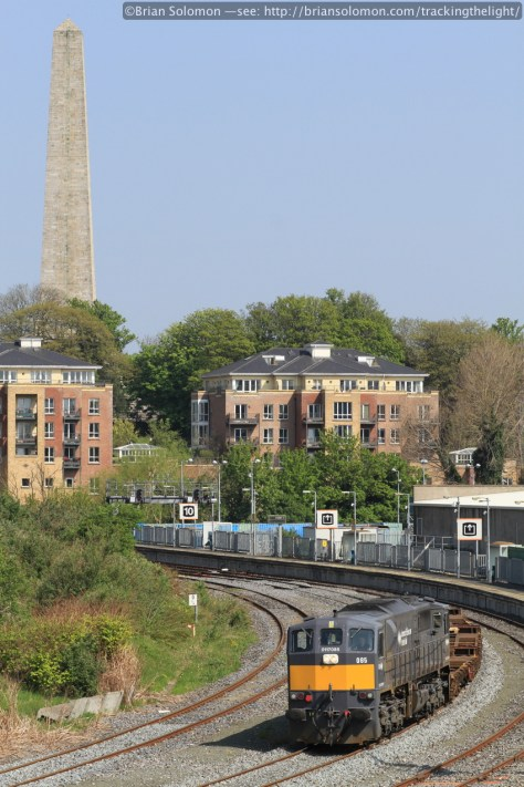 Irish Rail 085 with three flat wagons approaches Islandbridge Junction on April 29, 2014. Canon EOS 7D with 100mm lens. I opted for vertical composition to feature the monumental Wellington Testimonial that sits in Dublin's Phoenix Park. (Exposed at f9 1/500th of a second ISO 200).