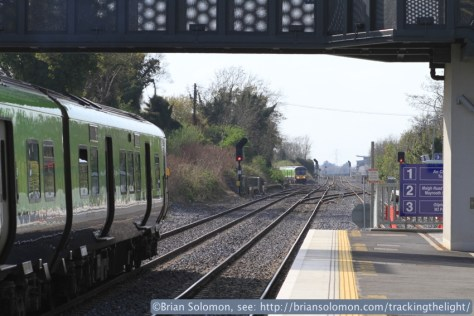 On the left is a 29000 series railcar destined for M3 Parkway, in the distance a train from Maynooth to Connolly Station can be seen at the new Junction where the route to M3 Parkway diverges to the right. Canon EOS 7D with 100mm lens.