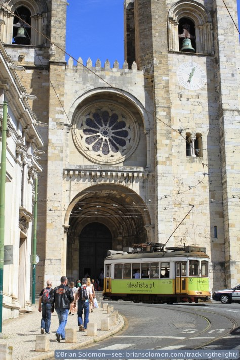 A tram works up hill by Lisbon's cathedral.