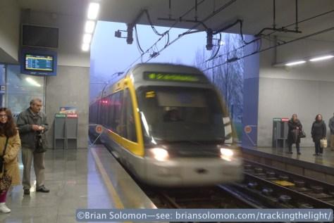 Tram_bursting_out_of_Fog_Trindade_station_Porto_P1630253