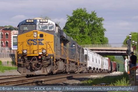 CSX Q423 (or L423) was working Palmer yard. In this view it pulls passed CP83 to double its train out of the yard. I exposed several telephoto views with the LX-7. By keeping the camera relatively low to the ground, I've minimized foreground distractions while allowing for a more dramatic perspective on the locomotives.