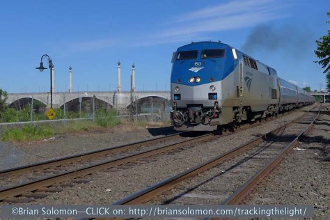 On the morning of June 22, 2014, Amtrak P42 150 leading train 145 on the former New Haven Railroad at Springfield, Massachusetts. Memorial Bridge spans the Connecticut River between Springfield and West Springfield. Exposed with a Lumix LX-7.
