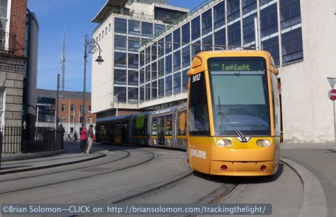 This outbound tram takes the corner near Busáras (Central Bus Station) in Dublin. Clear blue skies and rich afternoon sun isn't what I'd expect for Irish weather in July! Lumix LX7 photo