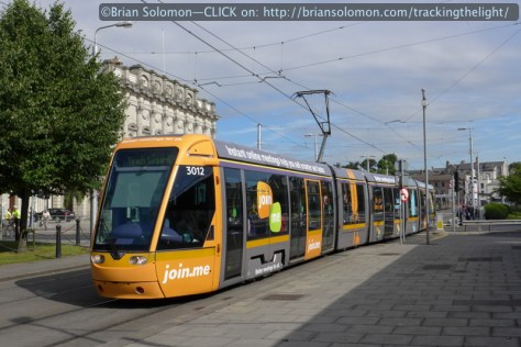 The shade of yellow on the front of the 'Join Me' LUAS tram reminded me of the Portugese multiple units I photographed in April. Lumix LX7 photo.