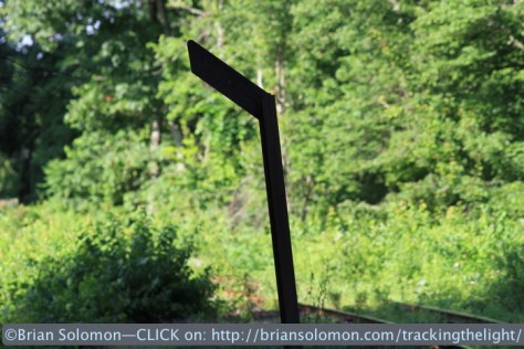 A plow warning signal near a crossing at Forest Lake. Mass-Central still retains many of these simple steam-era signals. Canon EOS 7D with 200mm lens.