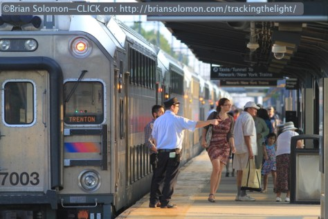 Mainline conductor directs passengers to the Dinky at Princeton Junction on June 29, 2014. Canon EOS 7D with 200 mm lens.