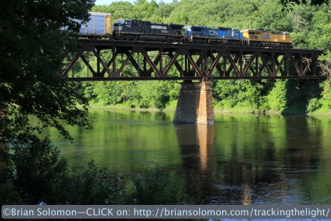 Pan Am Southern train 206 crosses the Connecticut River at East Deerfield, Massachusetts on the evening of July 10, 2014.
