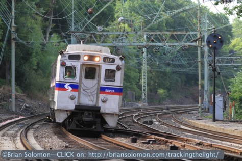 Minutes later an express train zips through Overbrook on track 2. Notice the signal on the far side of the tracks has cleared to 'Approach'. Canon EOS 7D photo.