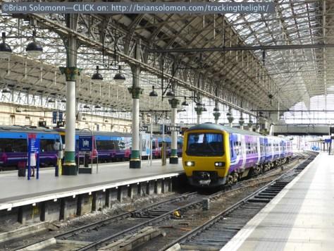 Electric train arrives. Lumix LX7 photo.