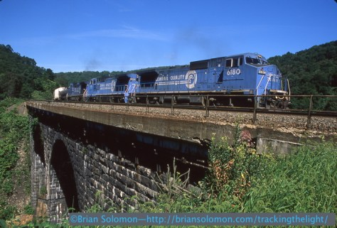 Conrail 6180 east at Big Viaduct Mineral Point PA September 5, 1997. Nikon N90S with 28mm lens, Fujichrome Provia 100F slide film.