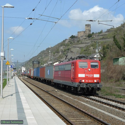 A DB class 151 electric leads a southward container train at Kaub, Germany. I've used the Lumix LX3 with the 1:1 (square) aspect ratio to frame the train with the castle on the side of the hill and lighting masts on the left. April 9, 2010.