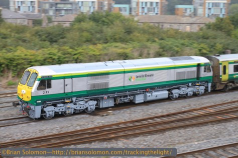 Irish Rail 215 works at the back of a Mark4 set from Cork. I panned this using my Canon EOS 7D with 40mm pancake lens at 1/40th of a second at f10, ISO 100. 12:45pm on September 18, 2014.