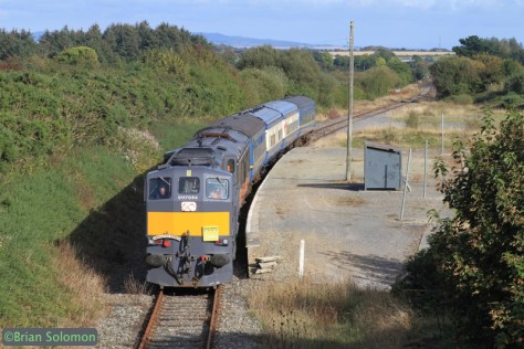 The Emerald Isle Express passes Ballycullane, County Wexford on September 29, 2014.  Regular schedule passenger service was withdrawn in 2010. The last sugarbeet train passed in early 2006—more than eight years ago. Canon EOS 7D with 100mm lens.