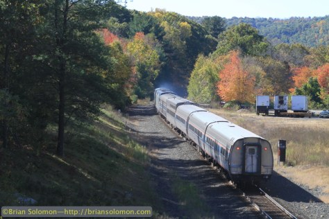 Trailing view of Amtrak 449 passing milepost 75 at West Warren, Massachusetts, the site of the old station.