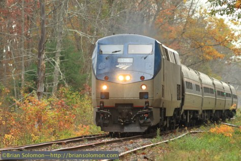 Amtrak train 57, Saturday's Vermonter works south of Amherst at milepost 82. A hiking trail runs parallel with the line at this location. New welded rail has been laid along the line. Canon EOS 7D with 200mm lens.