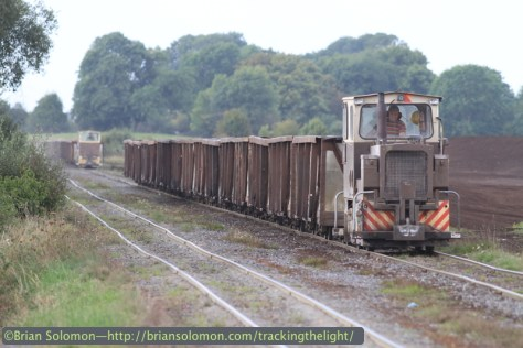 Bord na Mona empties approach a grade crossing near the Blackwater depot. Canon EOS 7D with 200mm lens.