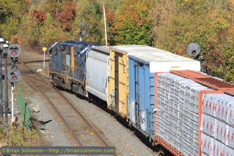 CSX's local snakes through CP83 as it stretched its train out of the yard at Palmer. The GP40-2s made a good roar going up the hill out of town. Canon EOS7D with 200mm lens.