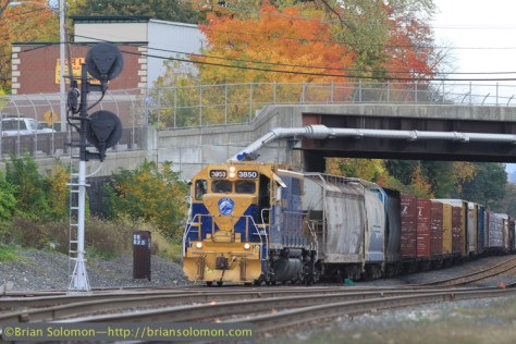 A New England Central local freight was working the interchange track in Palmer. Canon EOS7D with 200mm lens.