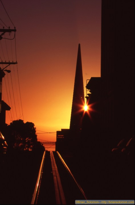 Wild fires make for great sunrises! Cable car tracks at sunrise with the Trans America Pyramid. No filters, no photoshop. Canon EOS 7D with 100-400mm lens on Fujichrome slide film.