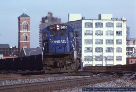 On January 8, 1989, a rare Conrail C30-7 (one of only ten on the roster) leads a westward empty coal train through Rochester, New York. I exposed a sequence of photos using my Leica M2 with a 200mm Telyt fitted to a Visoflex. In retrospect that was a bizarre and awkward camera-lens combination for making moving train photos. But I used it all the time with great results. A thin layer of high cloud softened the sun.