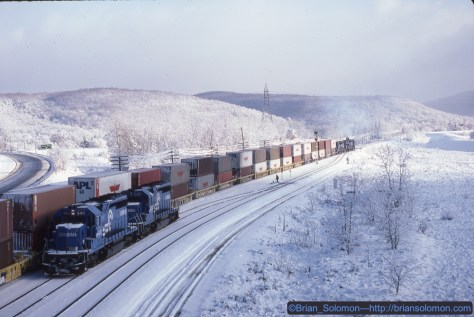 Conrail's TV302  was changing crews at Gang Mills_NY at 8:50 am on November 19, 1986. I had only a few minutes to figure out what to do and I'd never followed the old Erie east of Gang Mills before. Exposed with my room mate's Canon A1 with 50mm lens. Kodachrome 25.