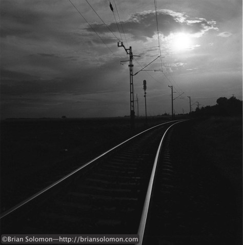 The sun sets over electrified MAV tracks at Csorna, Hungary in August 2003. Photo by Brian Solomon.