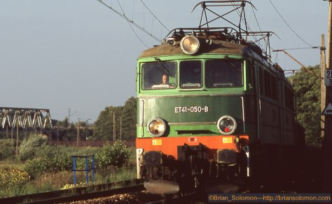 Polish National Railways class ET41 electric with coal train at Brzeszce,Poland. Exposed on Fujichrome using a Nikon N90S with f2.0135mm defocus lens.