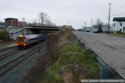 'This is my friend's cheap HO layout' (What a fool, he's tried to model Palmer!). [Miniature Effect].