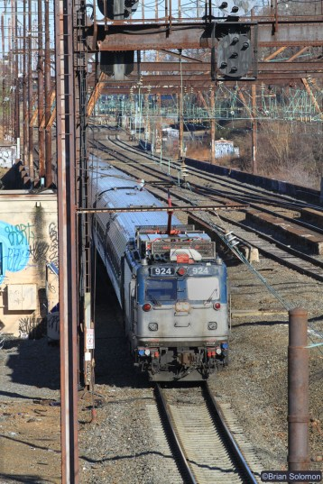 Amtrak AEM-7 924 crosses the Schuylkill River  working toward Philadelphia's 30th Street Station on the former Pennsylvania Railroad.. Canon EOS 7D with 200mm lens.