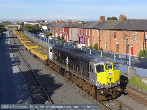 Irish Rail 074 is a vintage 1970s-era 071 diesel. Nice to catch in the sun with a spoil train from the East Road Bridge. Lumix LX7 phtoto.
