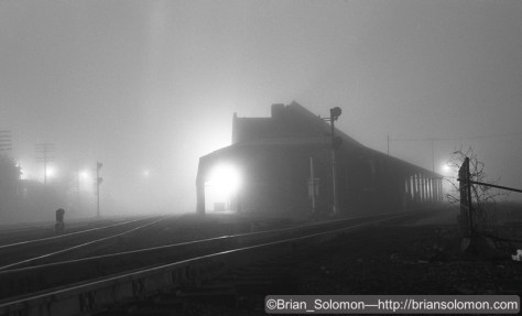 Over the years, I've made hundreds of night photos at Palmer, Massachusetts. I exposed this image on an exceptionally foggy May 1985 evening. My subject was the old Palmer Union Station near the crossing of Conrail's Boston & Albany line and the Central Vermont Railway. Today this old station has been restored and serves as the Steaming Tender restaurant. Tracking the Light viewers will find it a familiar subject, as I've often featured images in and around this building. Exposed on black & white film with a Leica 3A with 50mm Summitar lens.
