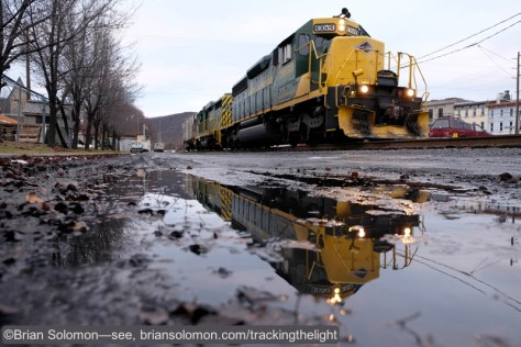 Puddles make for great reflective tools! Reading & Northern local freight at Tamaqua, Pennsylvania.