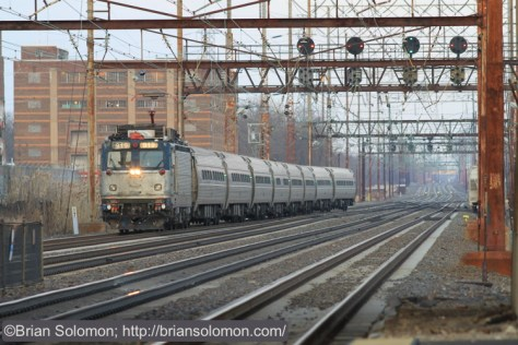 Amtrak AEM-7 919 leads a late-running train 93 at Marcus Hook, Pennsylvania. Canon EOS 7D with 200mm lens.