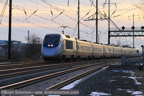 Amtrak's Acela Express catches the glint at Eddystone, Pennsylvania.