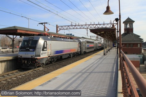 An NJT ALP46 shoves at the back of an inbound train: next stop, Hoboken. Canon EOS 7D with 20mm lens.