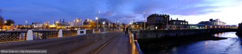 Dusk at Sean Heuston Bridge looking toward Heuston Station. I've made a broad sweep using the panorama feature. This sews together a bunch of images exposed in rapid order.