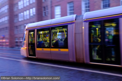 Pan of LUAS tram on Harcourt Street. ISO 3200 f4.0 1/30th of a second.