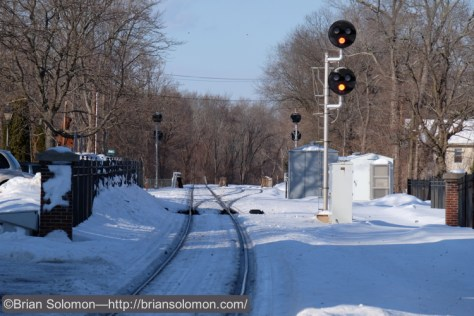 Amtrak signals at Windsor, Connecticut as photographed from the grade crossing at the station. Fuji X-T1 photo.