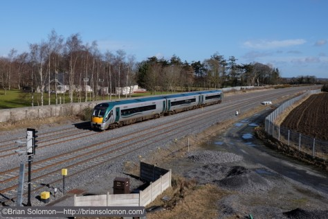 An Irish Rail 22K Rotem-built Intercity Rail Car flies up road at milepost 8 3/4. Fuji X-T1 photo.