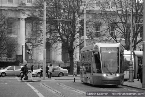 Outbound LUAS tram passes the Custom House on March 7, 2015—exposed with a Fuji X-T1 in black & white mode with digital red filtration.