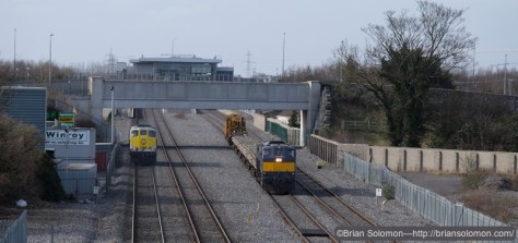 Irish 088 leads the Relay train up road near Clondalkin. Sister loco 074 is heading down road light engine as a 'swap' for the loco working a laden timber train to Waterford.