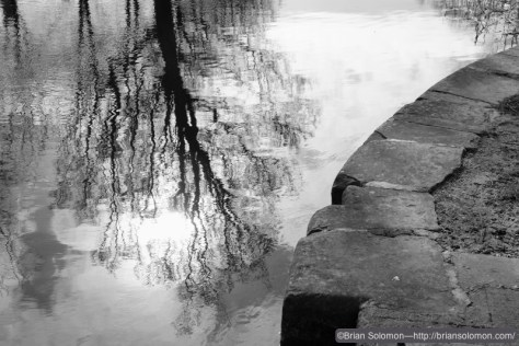 Reflections on the Grand Canal; black & white mode with in-camera red filter. Fuji X-T1 photo.
