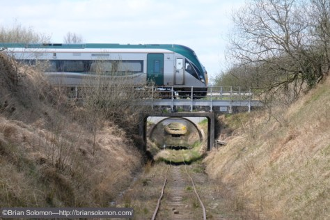 Dublin bound Irish Rail ICR (Intercity Railcar) crosses the Bord na Mona 3-foot gauge near Portlaoise. Fuji X-T1 photo.