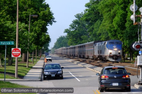 Amtrak number 53, the northward Autotrain, led by locomotives 831 and 816 at Ashland, Virginia. This train was running a on a 'limited clear' aspect behind a northward CSX intermodal freight. Fujifilm X-T1 with 18-135mm lens set to 135mm (telephoto). Notice the unusual grade crossing signal with the bracket arm at right.