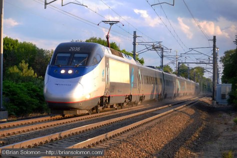 Nearing its top speed Amtrak's Acela Express, train 2166, races toward Boston. Exposed with a Fujifilm X-T1 digital camera. Shutter set at 1/1000th of second.