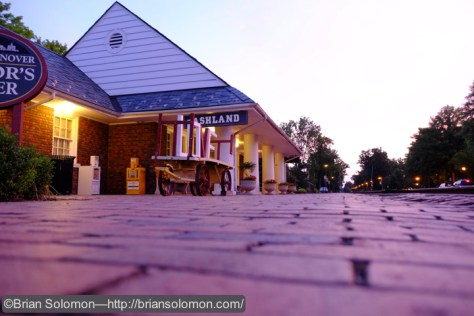 The old passenger station at Ashland, Virginia at dawn on June 8, 2015, looking north. Fujifilm X-T1 photo. (White balance set to 'daylight' rather than 'auto' to enhance the effect of sunrise).