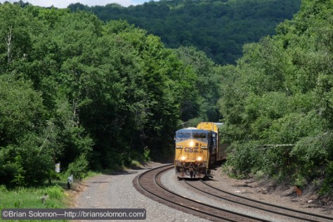 Hours pass between trains. Shortly before the noon-hour, CSX Q-264 with more than a mile of autoracks in tow.
